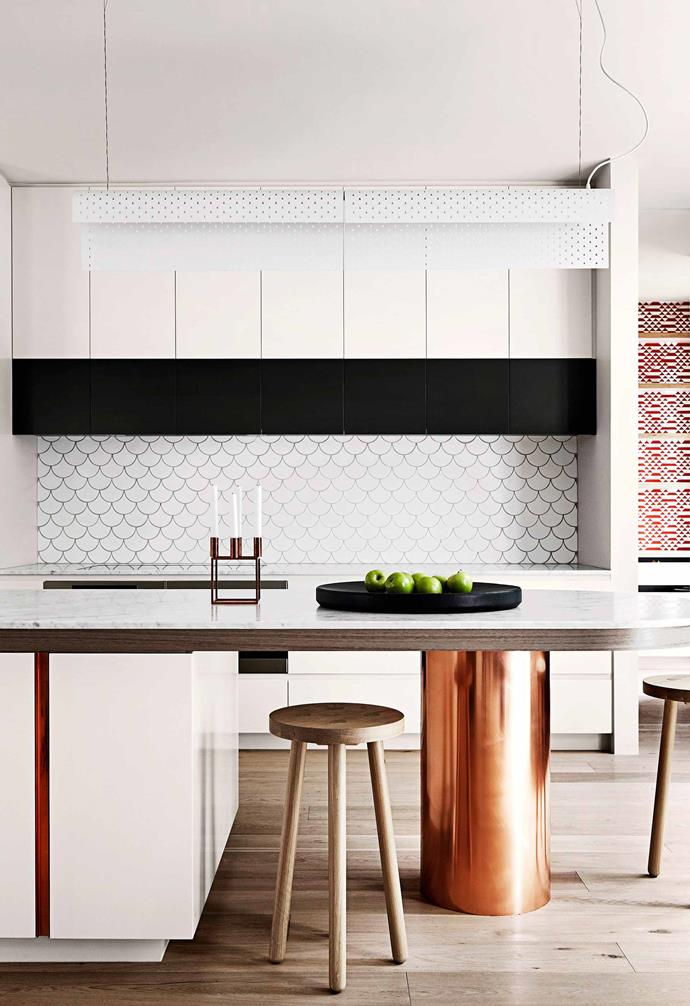 **Small accents** This kitchen features a white fish scale splashback with black grout for definition. A polished support beam holds up the kitchen island bench while also acting as a visual feature. *Photography: Sharyn Cairns / bauersyndication.com.au*
