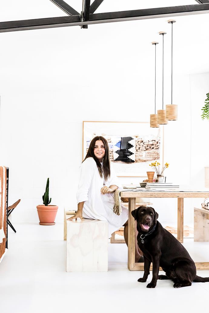 """The Pampa showroom in Byron Bay is stocked with handwoven textiles from South America. Poncho likes to keep his owners company in the office above the showroom. """"He's totally our boss,"""" Victoria says."""