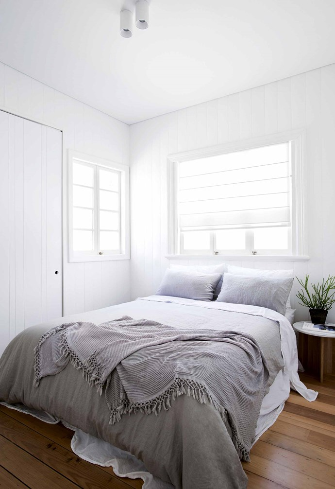 """A crisp palette of grey and white plays to the light, while the treatment of the ceiling, pushed up wherever possible, also visually expands the space. """"By creating a plasterboard ceiling with a P50 shadowline, we created continuity throughout the house, even though the roof changes levels and slopes,"""" says Alexandra.<br><br>**Master bedroom** The original master at the front of the house has been restored and improved with custom joinery. """"The vertical joints make the joinery feel like it's just a part of the wall,"""" says Alexandra. """"There is no separation between the two."""" Bedlinen, [In Bed](https://inbedstore.com/
