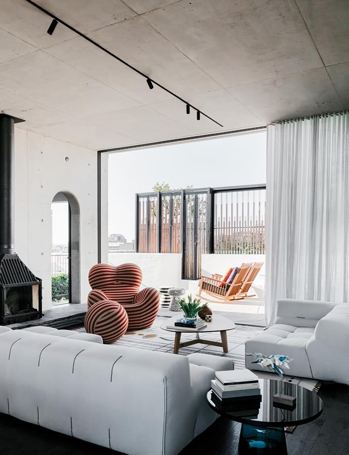 The central living area of this is penthouse apartment designed by architect Adam Haddow of SJB is generously sized, open and relaxed. Interior design firm BKH incorporated a Gaetano Pesce's 'Up Series 2000' chair into the space. *Photograph*: Felix Forest. From *Belle* October 2017.