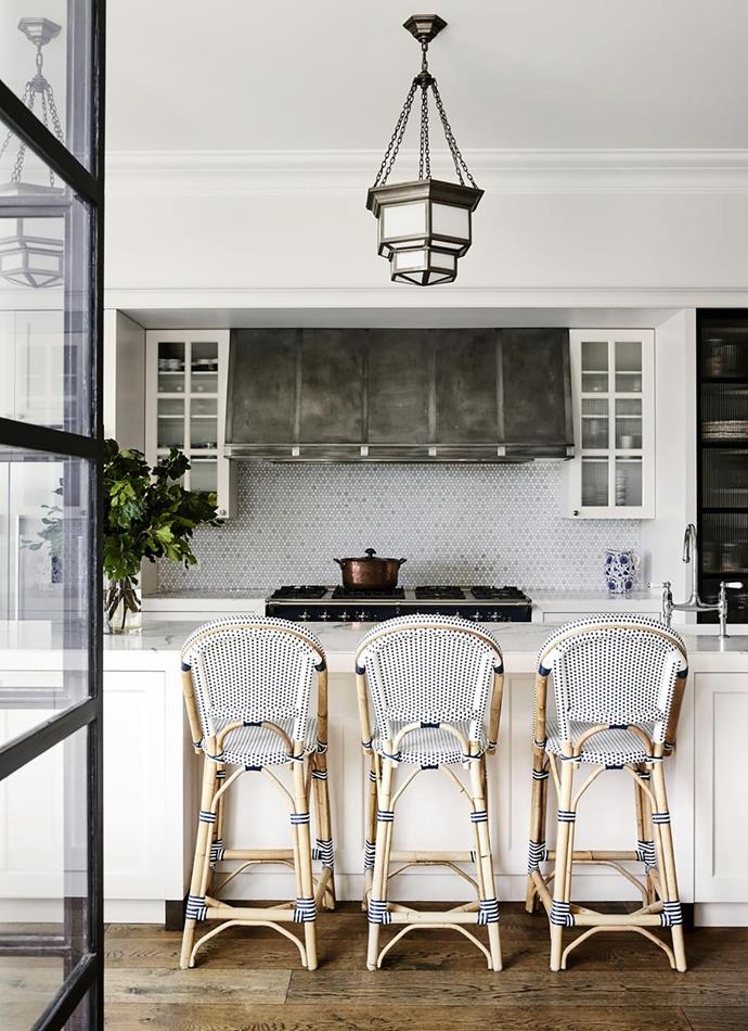 Deco glass pendants are a perfect fit for this classic kithcen. *Photo:* Anson Smart