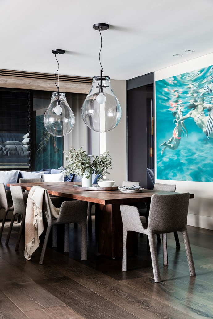 Curvaceous glass pendants suit this fluid dining space perfectly. *Photo:* Maree Homer