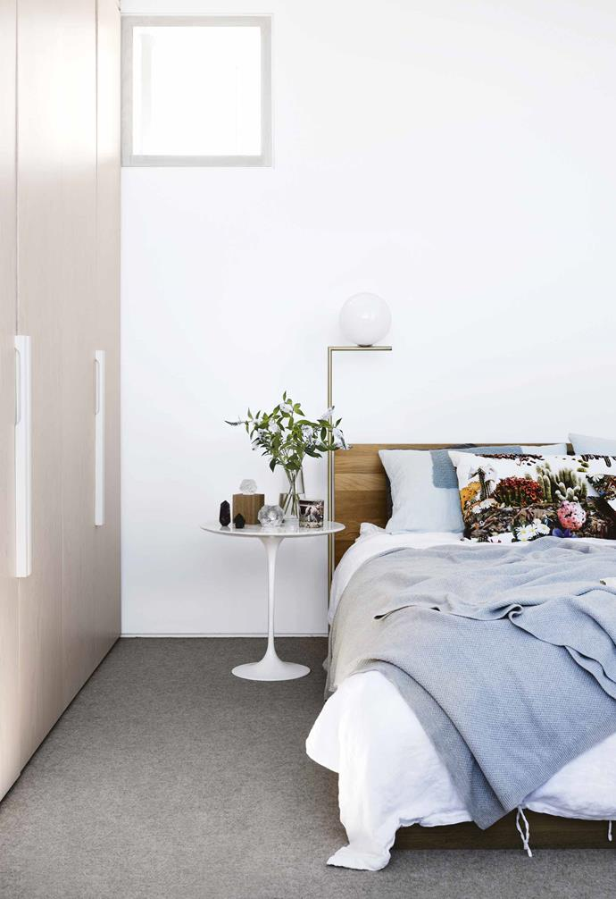 "A new bedroom was top of the wishlist, but where to squeeze it in without affecting the [facade](https://www.homestolove.com.au/fabulous-facades-18972|target=""_blank"") or the lofty proportions of the living space? A box-like addition conserves both and slots behind the facade, on top of a bathroom that's been updated into an ensuite.<br><br>**Master bedroom** ""If there's one word for the bedroom, it's light,"" says Sarah. The facade creates a privacy screen for the balcony while planes of glass ensure it's still a room with a knock-out urban view. Hoop pine premium-grade plywood from Plyco finished in [Porter's Paints](https://www.porterspaints.com/