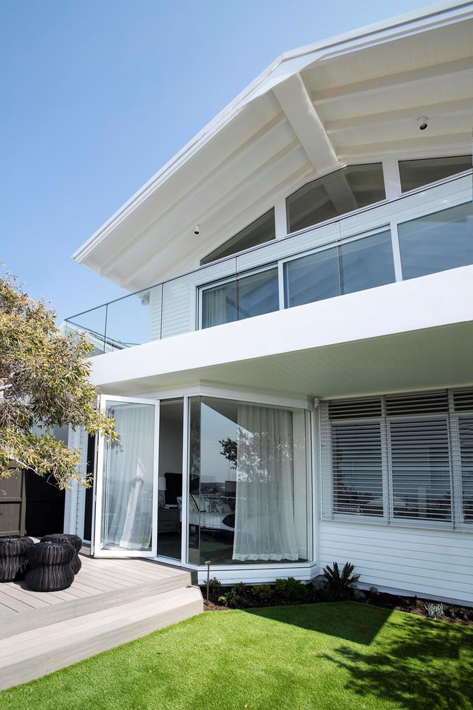 **After:** The brilliant white home stands out in contrast to the yellows and browns of the neighbouring properties.