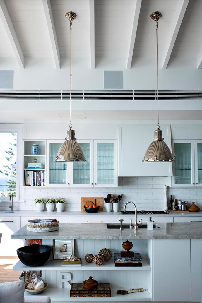 "**After:** Ralph Lauren lights hang in the [Hamptons-style kitchen](https://www.homestolove.com.au/deborah-huttons-hamptons-style-kitchen-renovation-19109|target=""_blank"")"