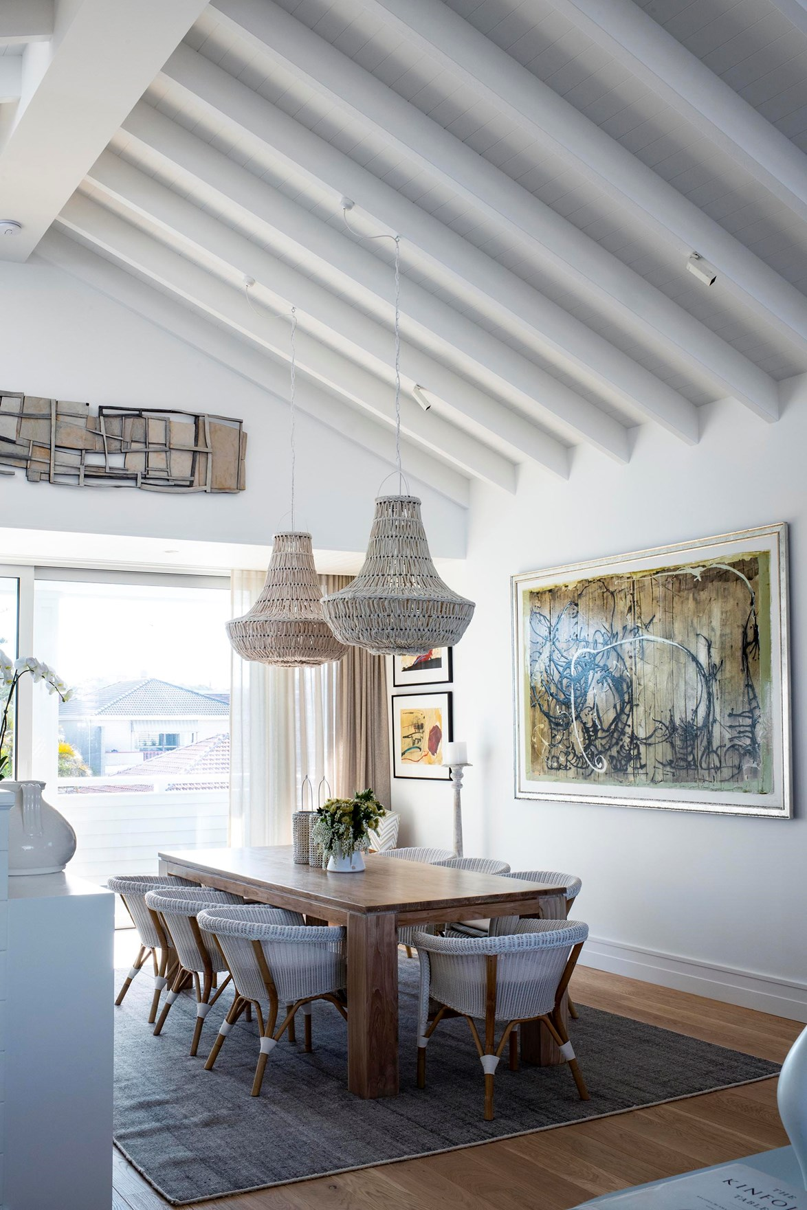 Raked ceilings and Linea Weatherboard inject the home with classic, coastal charm.