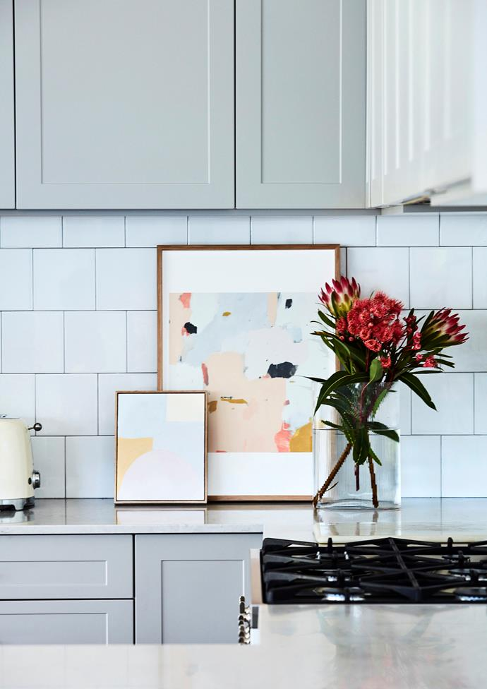 "Briar complemented her grey Freedom Kitchens cabinet doors with a Caesarstone benchtop in ""Noble Grey"", Smeg appliances, brass door hardware from Lew's Hardware and splashback tiles from Tiles By Kate."