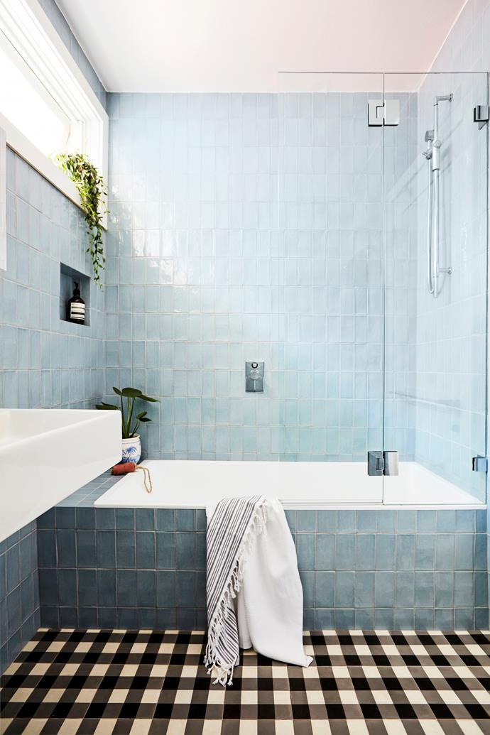 The bathroom was gutted but kept to the same configuration to save on costs. Briar and Mark did, however, combine the bath and shower to save space and because the original shower was tiny.