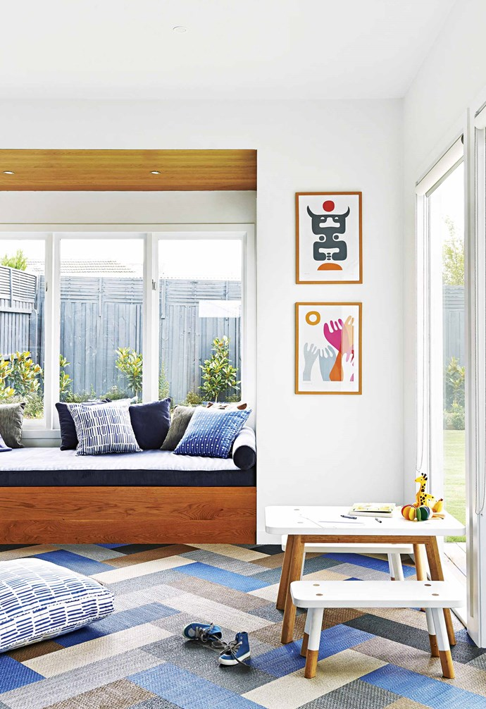 "And, in complete opposition to their previous all-white home, Lauren has added splashes of colour through pieces of furniture and art. ""At the moment, I seem to be buying everything in pink,"" she says, ""which may just be because I have three sons and I'm trying to channel some feminine energy!""<br><br>**Playroom** The Bolon carpet tiles from The Andrews Group have withstood the daily rigours of three lively boys. ""They're made of vinyl, so you can vacuum or mop them,"" says Lauren. ""The kids eat in there and it doesn't matter if they spill food."" The floor's geometric pattern combines with the 'Babanees' table setting from Green Cathedral and bright Elroyink prints to form an inviting kid-friendly zone. Isa form Patterned cushions and floor cushion, [Nerida Hansen Print & Textiles](https://agency.neridahansen.com/