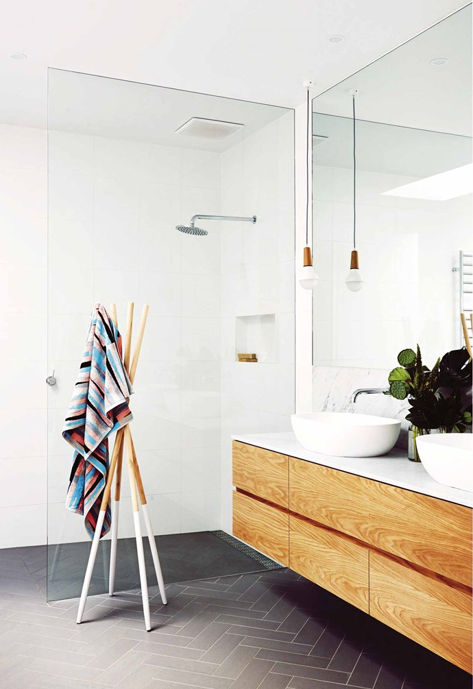 "**Biggest mistake** ""We don't feel like we made any, except probably when it came to budget,"" says Lauren. ""But that happens – once you're on the path, you're on it. If I could go back, I'd add 20 per cent to what we thought everything would cost as a contingency.""<br><br>**Bathroom** The details shine here with floor tiles from Academy Tiles and the Stephanie Ng Design 'Scoop' pendant light. Ninnho towels and tienko towel stand, Ampersand, 0425 285 196."