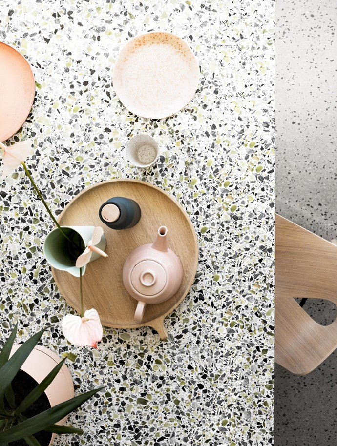 The benchtops, with their medium-grain terrazzo chips in olive green, black and white, reflect the owners' Mediterranean heritage.