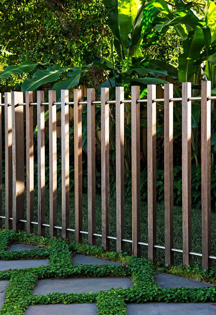 **Back garden** A spotted gum timber batten fence, threaded with stainless-steel rod, delineates the space between entertaining area and pet play lawn.