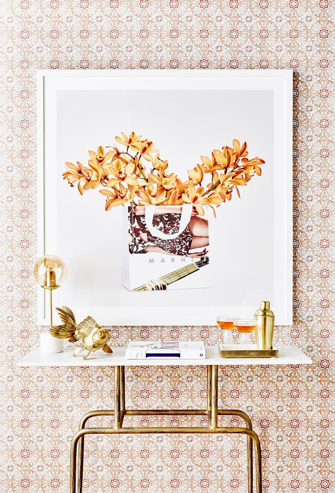 """**Style up a storm:** Breathe new life into those [empty corners](https://www.homestolove.com.au/decorating-ideas-for-empty-spaces-10151 target=""""_blank"""") by creating an inviting """"nook"""". Cover the walls with a roll or two of wallpaper in a fun print, add an eye-catching artwork in an inexpensive frame, then [create a vignette](http://www.homestolove.com.au/how-to-style-a-vignette-5757 target=""""_blank"""") of items atop a hall table or bar cart. *Photo:* Maree Homer"""