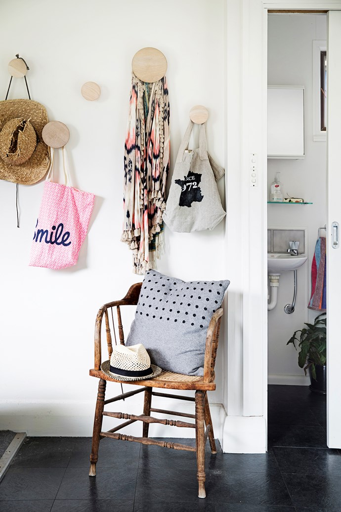 **Wall storage:** Round wooden wall hooks provide a stylish spot to hang those miscellaneous, hard-to-store objects like bags, scarves and hats. Grab some sample pots of paint in bright colours from Bunnings and make a feature of them.