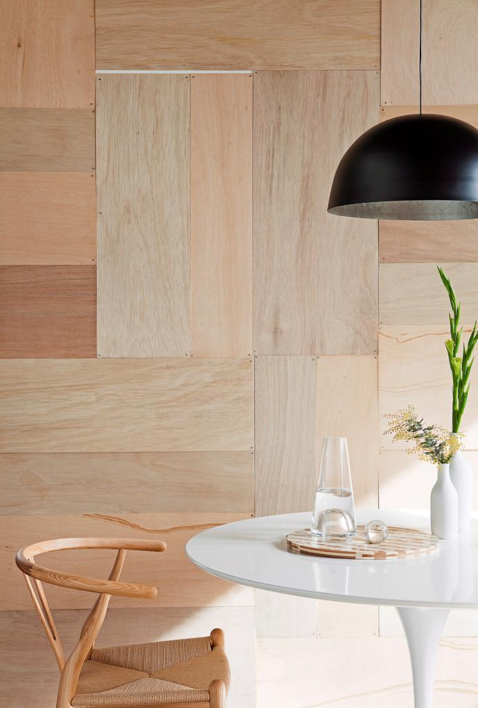 """**DIY feature wall:** Got an unsightly wall that needs hiding? Cover it with a wall of [plywood](https://www.homestolove.com.au/diy-plywood-interior-design-ideas-5085 target=""""_blank"""") panels secured in place with a nail gun. You can keep it simple like in the example above, or arrange smaller panels in a more decorative stretcher bond or herringbone pattern. Finish by painting it your favourite shade. *Photo:* Chris Warnes"""