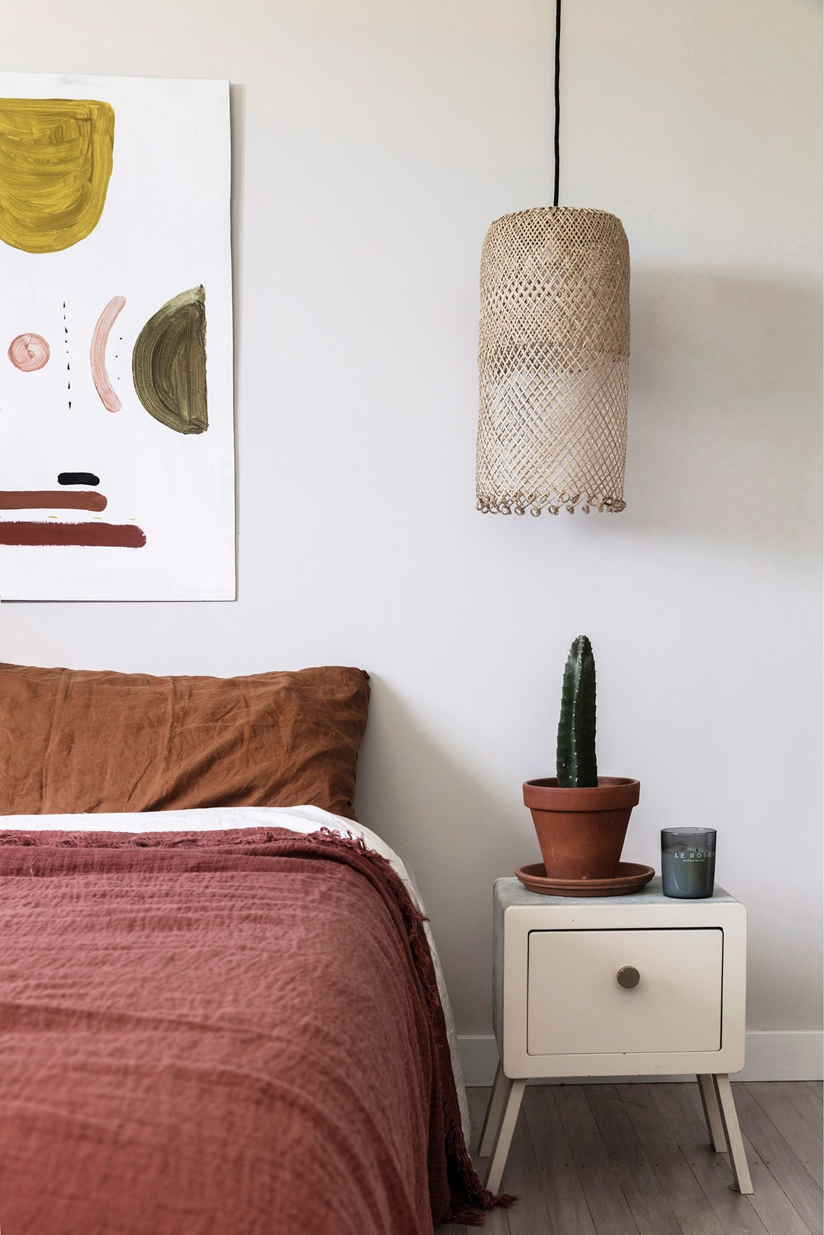 Textured linen bedding in earthy tones will create a cosy vibe in the bedroom.