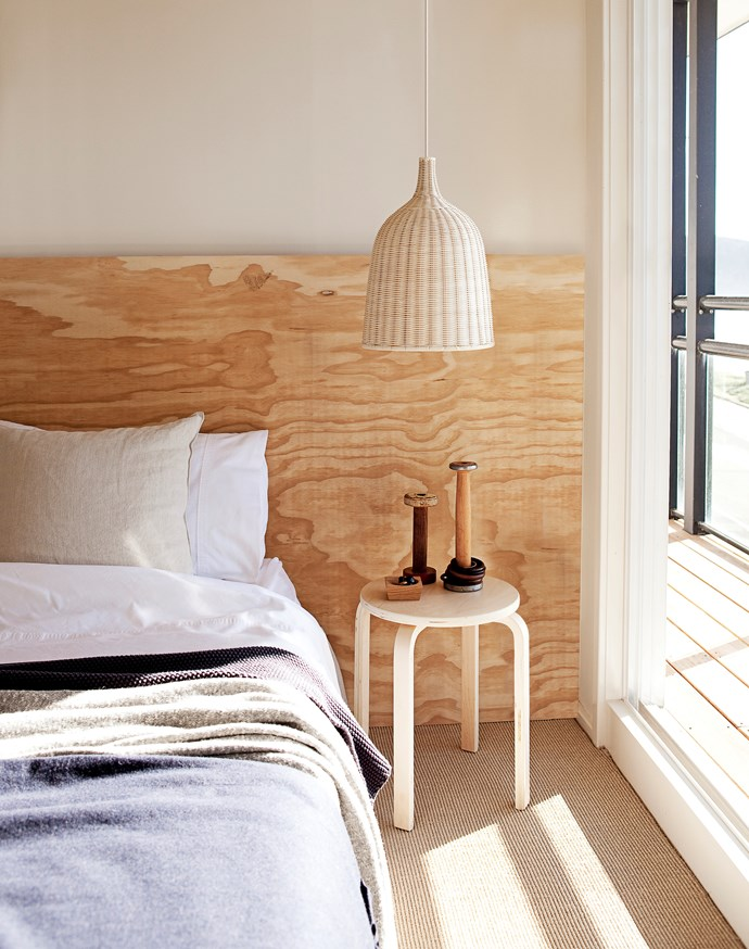 **DIY bedhead:** If you're handy with a hammer and nails, you'll make short work of this timber bedhead. Have the timber cut to size by your hardware store to save time. Not handy? Use a rustic old door left natural or whitewashed.
