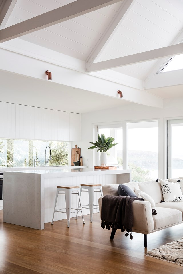 "If making a statement isn't your thing, be inspired by this [beach house renovation](https://www.homestolove.com.au/beach-house-renovation-19763|target=""_blank"") in which the island seems to melt into the surrounding space. This look was achieved by sticking to a neutral, monochromatic colour palette and by installing the kitchen sink on the galley, rather than the island."