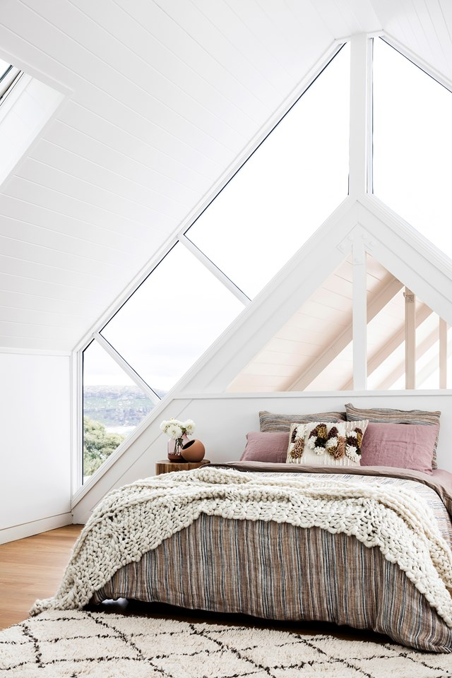 """After unearthing structural Oregon trusses and western red cedar boards lining the ceilings to the gable roof, the owners of this [renovated beach house](https://www.homestolove.com.au/beach-house-renovation-19763