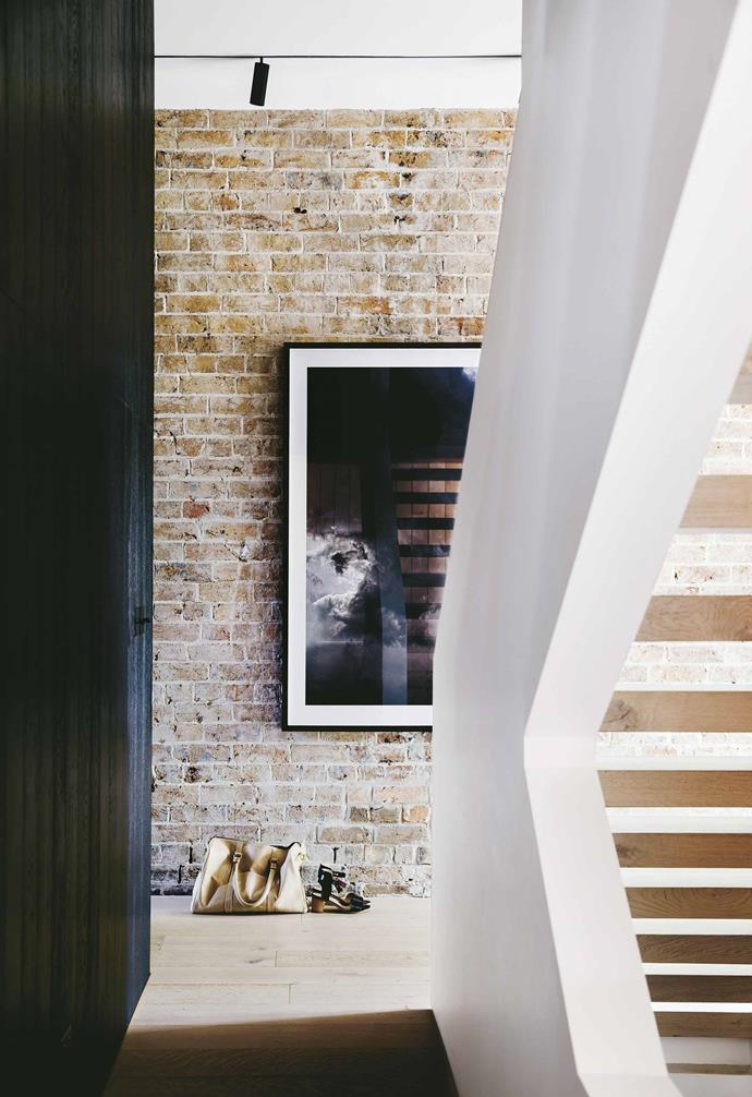 """Renovating a [Victorian terrace house](https://www.homestolove.com.au/modern-terrace-house-design-20335 target=""""_blank"""") usually means a battle to bring [natural light](https://www.homestolove.com.au/how-to-increase-natural-light-in-home-15836 target=""""_blank"""") into the centre of the dwelling. """"Getting light, ventilation and a sense of space into a terrace can be hard,"""" says Steve. """"Usually you're limited to getting light in at either end of the property.""""<br><br>**Stairs** The stairs take advantage of the laneway extension with the open treads further maximising light in the north-facing space. Artwork: Photograph by Trevor Mein, [Otomys](https://otomys.com/ target=""""_blank"""" rel=""""nofollow"""")."""