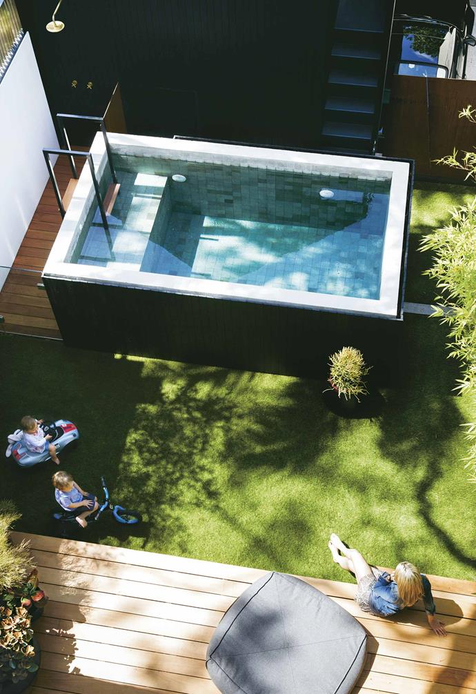"**Exterior** Belinda relaxes with Toby and Ella in the neat backyard set-up centred around the raised pool.<br><br>*For info on Tom and Belinda's work at Juicy Design, visit [Juicy Design](http://juicydesign.com.au/|target=""_blank""