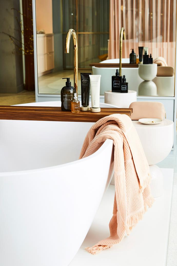 A polished brass tap adds a luxe touch to this bathroom. *Photo:*
