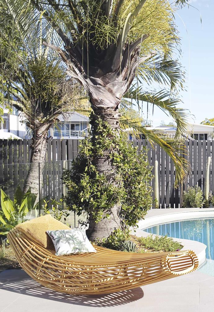 """**Exterior** Palm Springs-style plantings add rich colour to the pool area. Cappellini 'body raft' chaise, [Cult](https://cultdesign.com.au/