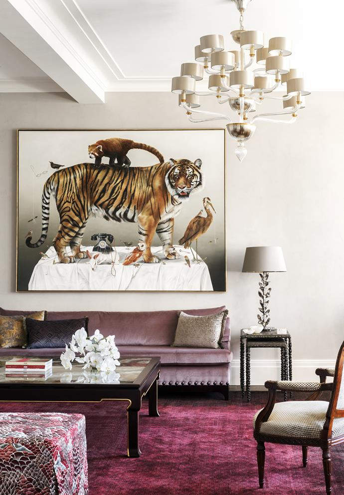 A dramatic artwork by Kate Bergin hangs in the formal living room of this home designed by Thomas Hamel & Associates and the late Stuart Rattle. The space also features a custom sofa in 'Plushy' fabric in Lavender from Perennials and a custom silk rug from Behruz Sutdio. *Photograph*: Matt Lowden. From *Belle* April 2019.