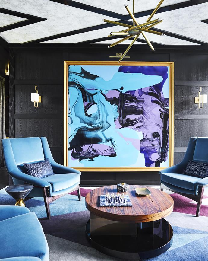 Designer Greg Natale selected 'Inca' armchairs from Brabbu to perfectly complement a striking artwork by Dale Frank. 'Lallan Centre' coffee table from Brabbu. 'Spiral VL-6' brass chandelier from Gallery L7, LA. *Photograph*: Anson Smart. From *Belle* October 2018.