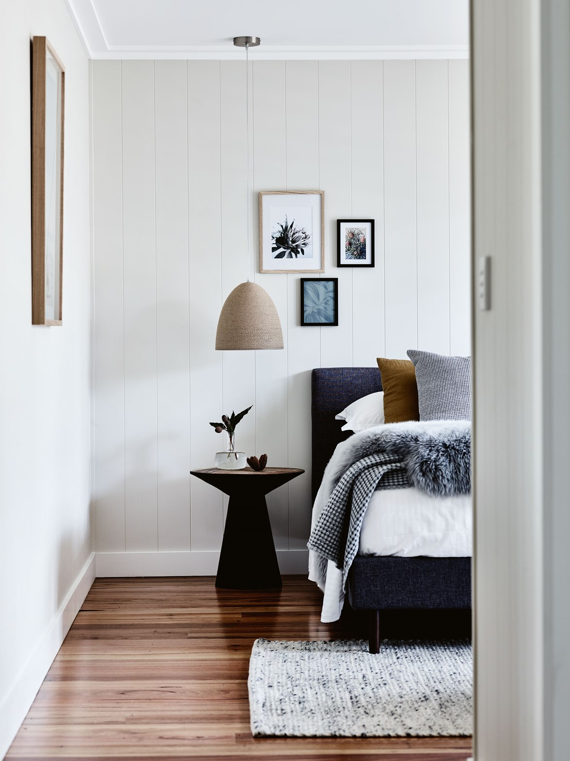 No one wants to step out of a warm bed onto a cold floor first thing in the morning. If you have floorboards in your bedroom, a rug beside or at the end of the bed will help to cosy up the space in winter.