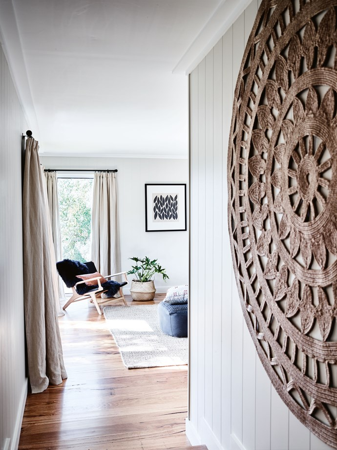 "One of the couple's guest suites features a floor rug as a wall hanging. The interior is [painted in Dulux](https://www.homestolove.com.au/dulux-paint-colour-trends-2019-18959|target=""_blank"") Half Duck and the curtains are from [Linen Shed](https://www.linenshed.com.au/