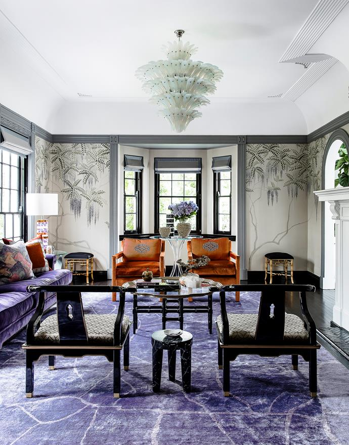 This room sings with hues of purple and orange thanks to Brendan Wong Design. De Gournay 'Wisteria' handpainted silk wallpaper. 'Milo' upholstered armchairs from Jason Mowen. Custom silk rug by Brendan Wong Design. *Photograph*: Maree Homer. From *Belle* June/July 2016.