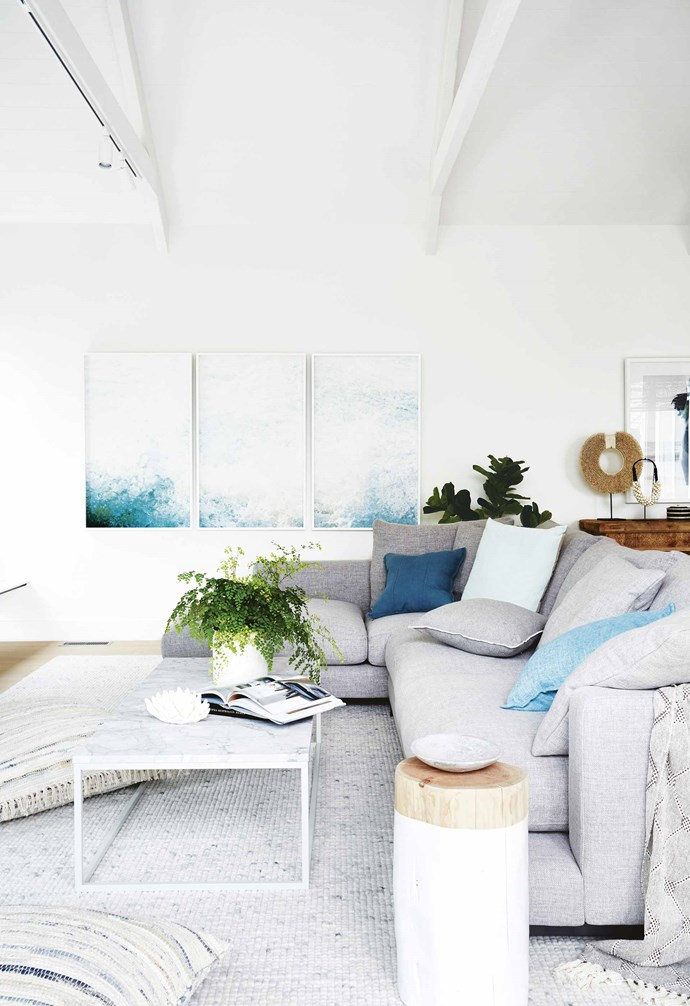 "We added a [cathedral ceiling](https://www.homestolove.com.au/ceiling-types-15321|target=""_blank"") in the new living/dining/kitchen area, which would create a sense of space and offers a point of difference.<br><br>**Living area** The photographic triptych by Chris Warnes from [Otomys](https://otomys.com/