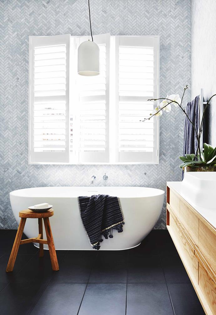 """My concept for the home was that I wanted to feel as if I was on holiday at home. I love it when you go away and you're excited to be in a space that you can relax in.<br><br>**Bathroom** Deanne's eye for details is seen here with walls covered in marble herringbone tiles from [National Tiles](https://www.nationaltiles.com.au/