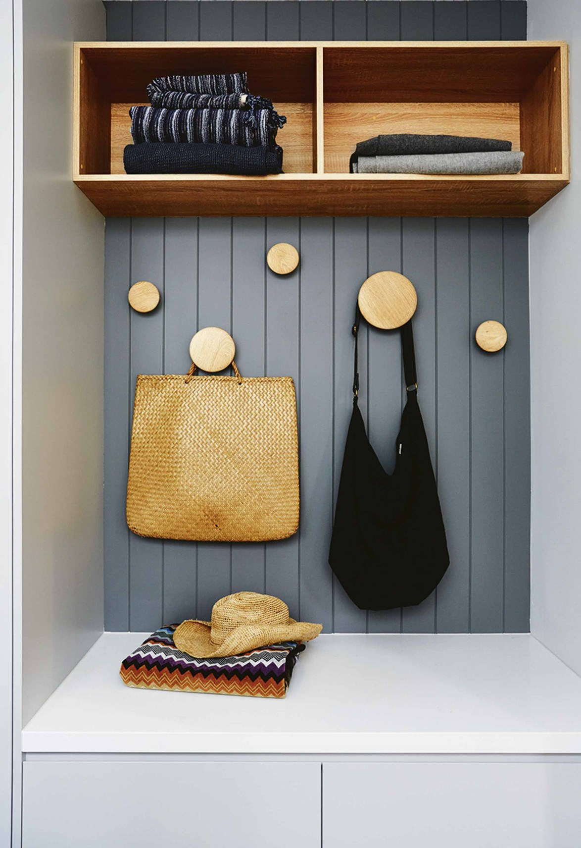 This handy storage nook is in the laundry and is the ideal spot for school bags, umbrellas and towels.
