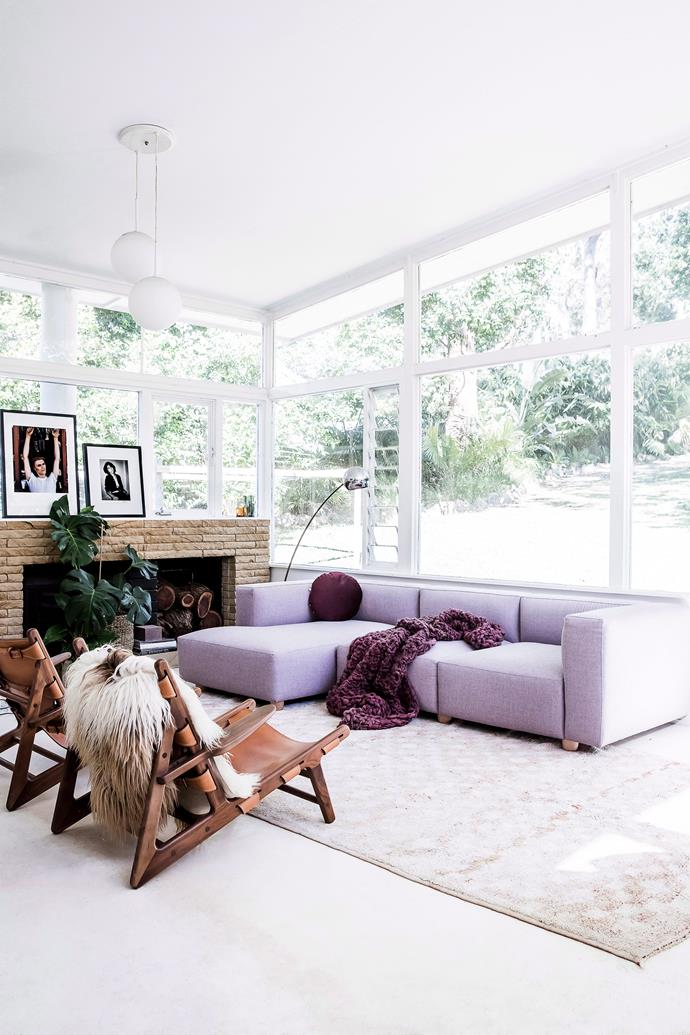 A lilac sofa paired with deep purple accessories adds depth to this otherwise monochromatic living room. *Photo: Maree Homer / bauersyndication.com.au*