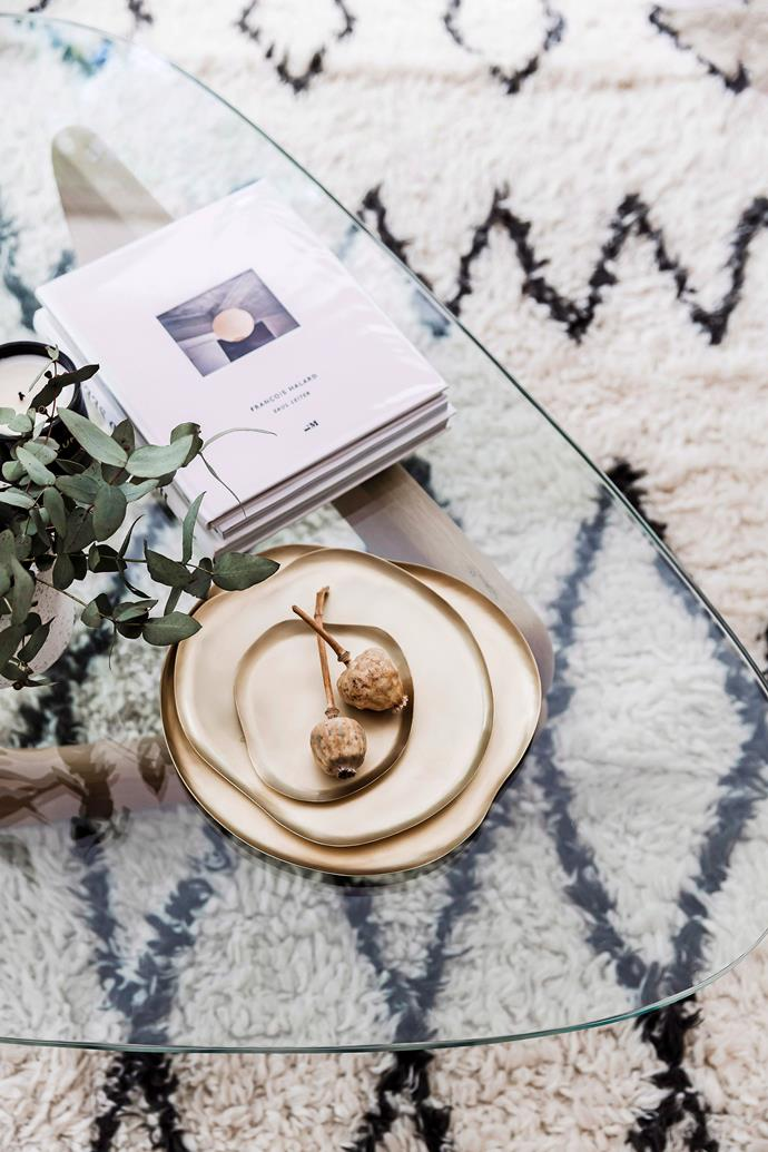Pairing a glass-topped coffee table with a patterned rug will create the illusion of space, while allowing the rug to shine in all of its glory. *Photo: Maree Homer / bauersyndication.com.au*