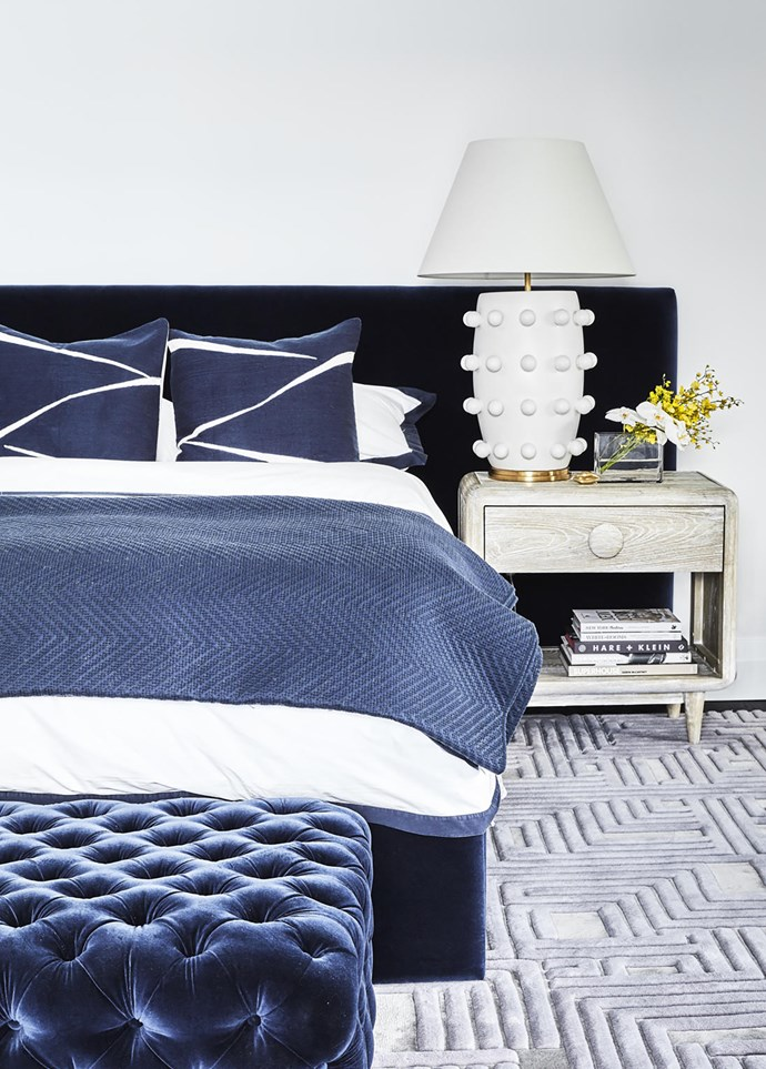 'Mirabelle' headboard from Heatherly Designs, Kelly Wearstler 'Linden' table lamp on a 'Westover' nightstand from Max Sparrow. Tufted ottoman from Arthur G. Rug from RC+D.