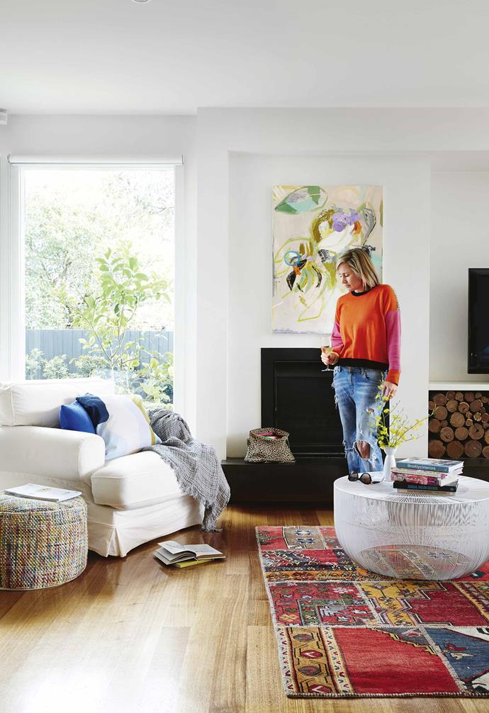 "Anna was equally sold on the fusion of old and new within the revamped house. ""I loved our old terrace but moving to a home combining period features with a contemporary extension was a new chapter,"" she says. ""Mixing styles and eras was all part of the enticement and decorating challenge for me.""<br><br>**Living area** A vintage kelim from [Loom Rugs](http://loomrugs.com/