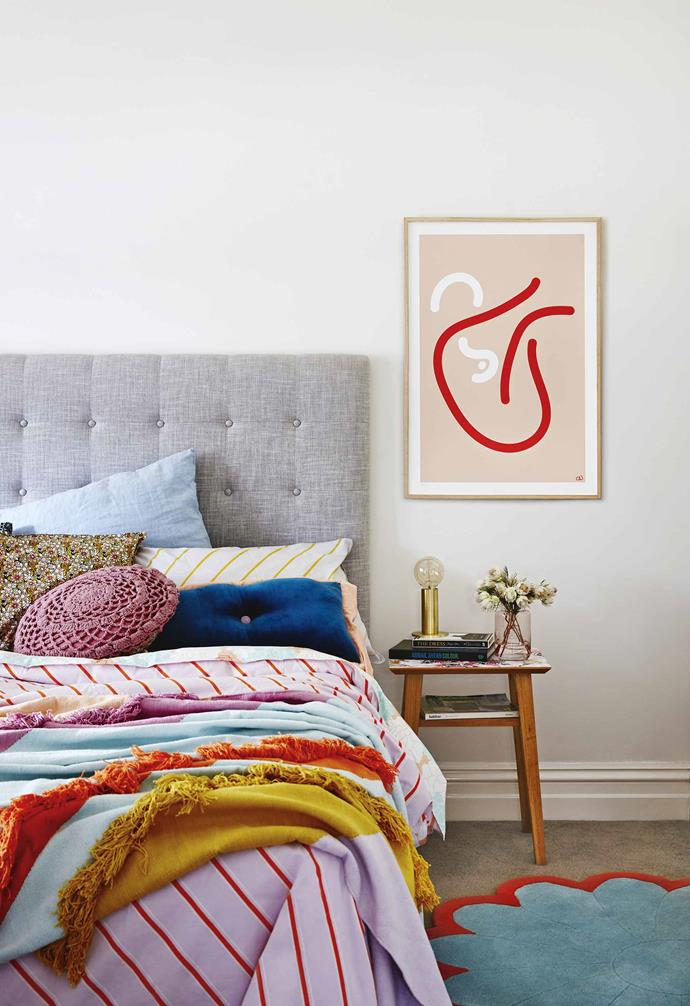 "A contemporary floral abstract artwork by Ali McNabney-Stevens was commissioned to sit proudly above [the fireplace](https://www.homestolove.com.au/how-to-choose-the-right-fireplace-7114|target=""_blank""). ""I wanted to make this space moody and grown up,"" says Anna. ""I also wanted a zone where I could mix [Art Deco](https://www.homestolove.com.au/modern-art-deco-style-4254