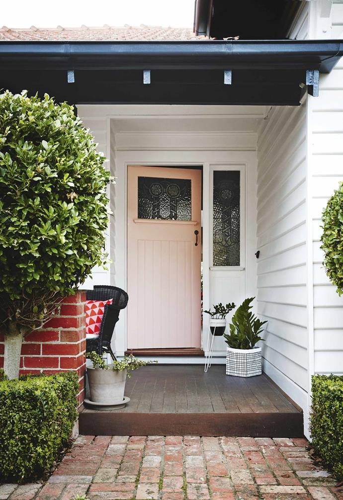 "Finally, it was time for Anna to turn her attention to the garden and finish off the exterior with a new [deck](https://www.homestolove.com.au/balcony-and-deck-design-ideas-2458|target=""_blank"") and paint makeover. Fresh garden beds laden with hydrangeas and port wine magnolias were planted. The home was finished off with a [perfect powder-pink front door](https://www.homestolove.com.au/front-door-colour-inspiration-6621