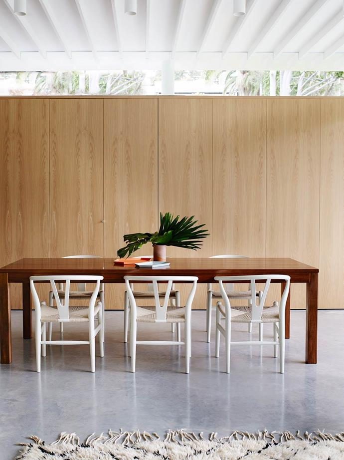"Polished concrete floors in the dining room of this [Sydney home](https://www.homestolove.com.au/modernism-inspires-laid-back-family-home-2762|target=""_blank"") offset the custom-made European-oak joinery.*Photograph*: Prue Ruscoe 