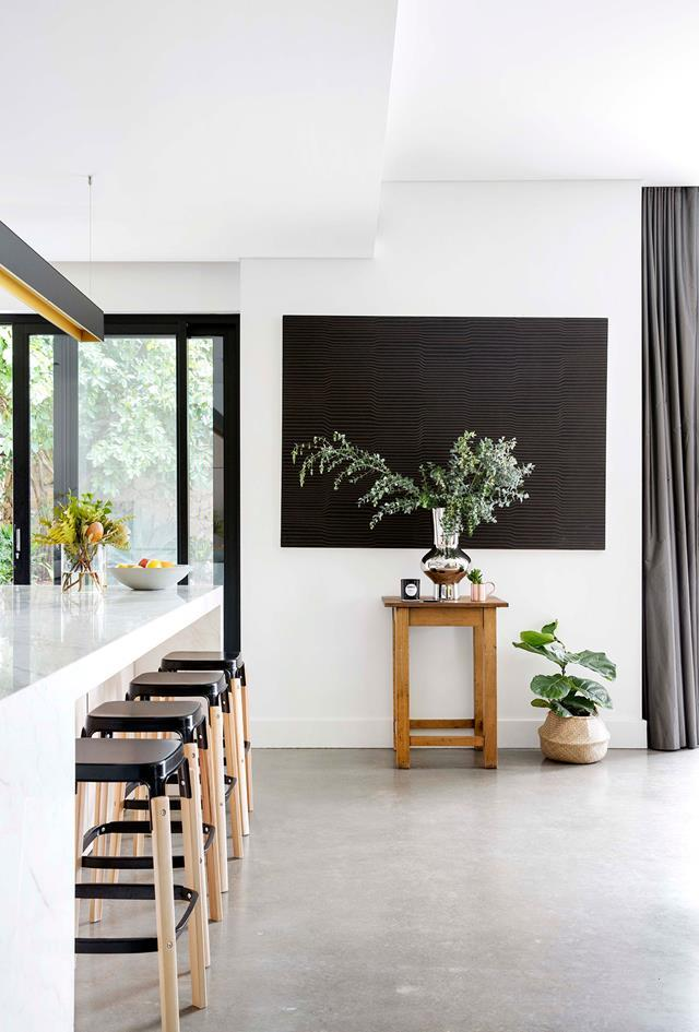"The interiors of this [1920s home in Fremantle](https://www.homestolove.com.au/1920s-home-renovation-6288|target=""_blank"") represent a gentler, family-friendly take on an industrial aesthetic, with concrete floors and anodised aluminium warmed by limed ply and plush textiles. *Photograph*: Angelita Bonetti"