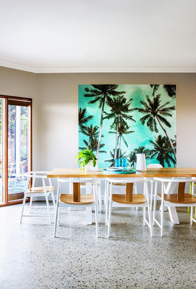 """A panel of Too Palmy wallpaper from Kawaiian Lion is hung as an artwork in the dining area of this [beachside bungalow in Adelaide](https://www.homestolove.com.au/a-restored-1915-beach-house-by-the-sea-in-adelaide-5231