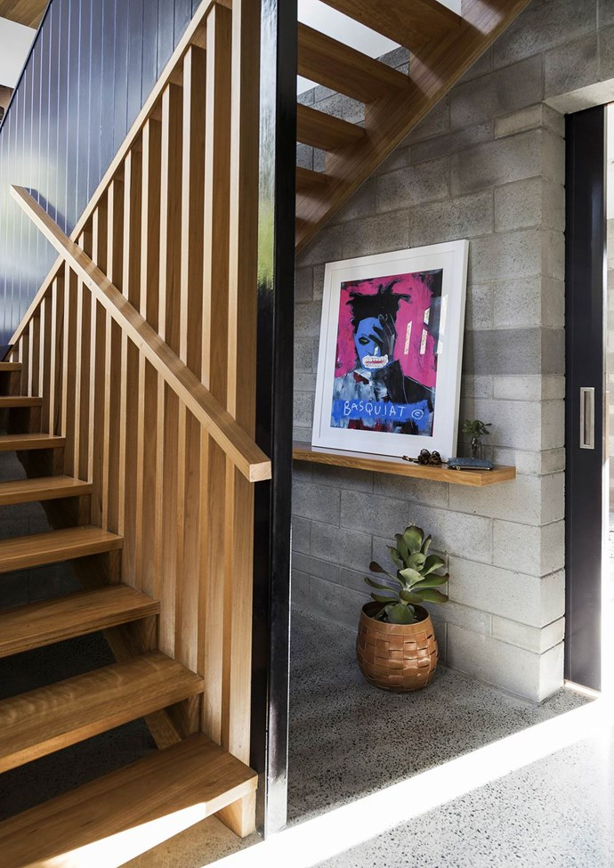 "In the downstairs foyer of this [Brisbane home](https://www.homestolove.com.au/gallery-laura-and-alistairs-contemporary-family-home-1719|target=""_blank""), a handy shelf by the front door is simply dressed with a Jean-Michel Basquiat art print from Jamieson's Home & Fashion. *Photograph*:"