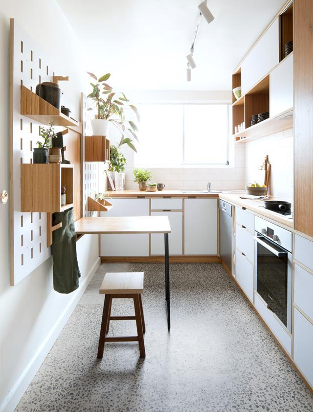 "This bespoke, [budget-friendly kitchen](https://www.homestolove.com.au/compact-apartment-kitchen-renovation-19005|target=""_blank"") features a polished concrete with exposed aggregate. *Styling*: Toni Briggs"