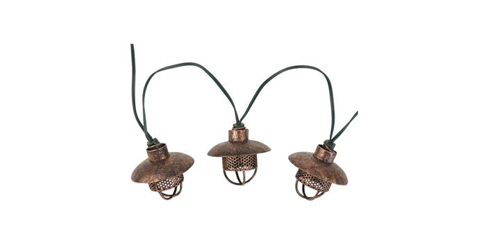 """Copper lanterns with LED bulbs cast a warm white glow. 'Dante' 4.5 **solar string lights**, $42, Smart Living Home & Garden; [smartlivinghg.com](https://smartlivinghg.com/