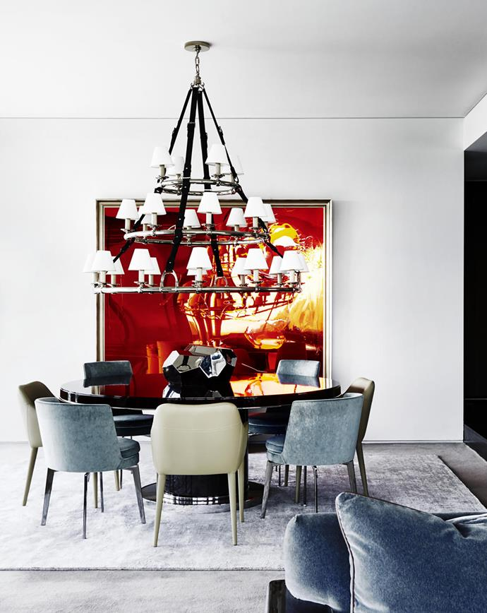 Flexform 'Feel Good' chairs from Fanuli and 'Embellish' chairs from Zuster surround a Ralph Lauren Home table. Custom rug from RC+D. Ralph Lauren Home pendant light. Artwork, Hitting the Hay by Dale Frank, from Neon Parc. Glass sculpture by Mark Douglass.