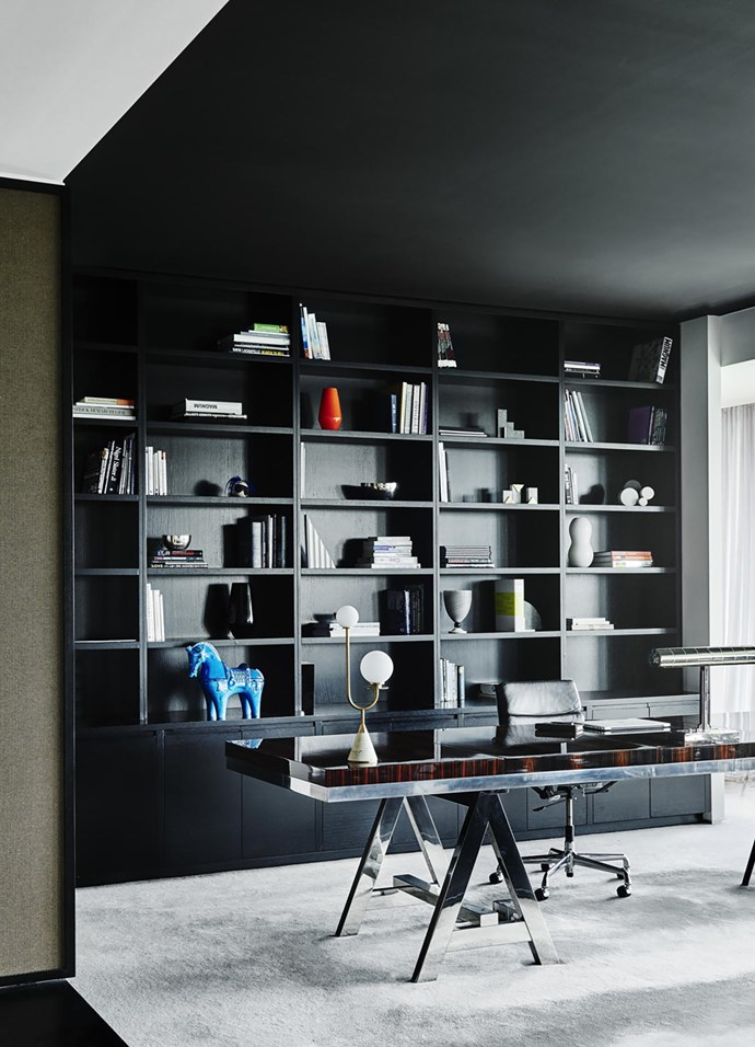 A custom desk by Armani Casa in polished macassar ebony veneer and stainless steel with a Knoll chair in the study. Joinery in European oak with hand-rubbed black japan finish.