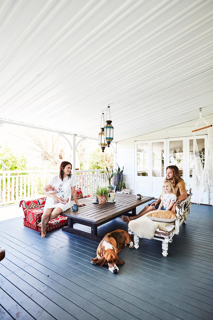 Turkish floor cushions and a low table create a relaxing vibe out on the verandah.